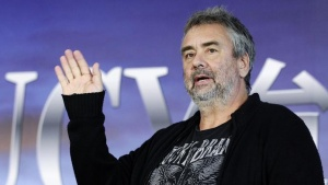 "French film director Luc Besson waves to reporters during a news conference for his movie ""Lucy"" in Taipei November 1, 2013. REUTERS/Pichi Chuang/Files"