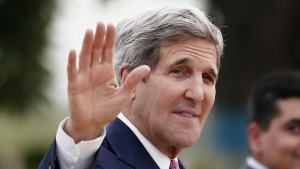 U.S. Secretary of State John Kerry waves towards the media upon his arrival at the airport in New Delhi July 30, 2014. REUTERS/Adnan Abidi