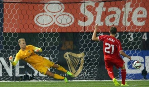 Jul 30, 2014; Bronx, NY, USA; Liverpool FC midfielder Lucas Leiva (21) scores a goal against Manchester City FC goalkeeper Joe Hart (1) during penalty kicks of a game at Yankee Stadium. Mandatory Credit: Brad Penner-USA TODAY Sports