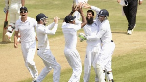 England's Moeen Ali celebrates after dismissing India's Bhuvneshwar Kumar during the third cricket test match at the Rose Bowl cricket ground, Southampton, England July 31, 2014.  REUTERS/Philip Brown