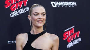 "Cast member Jaime King poses at the premiere of ""Sin City: A Dame to Kill For"" in Hollywood, California August 19, 2014.REUTERS/Mario Anzuoni"