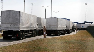Trucks of a Russian convoy carrying humanitarian aid for Ukraine drive onto the territory of a Russia-Ukraine border crossing point Donetsk in Russia's Rostov Region, August 22, 2014. REUTERS/Alexander Demianchuk