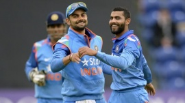 Virat Kohli congratulates teammate Ravindra Jadeja (R) after the dismissal of England's Ben Stokes (not pictured) during the second one-day international cricket match at the Swalec stadium, Cardiff August 27, 2014. REUTERS/Philip Brown