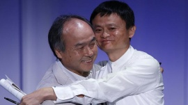 SoftBank Corp. Chief Executive Masayoshi Son (L) hugs Jack Ma, founder and executive chair of Alibaba Group Holding, during the SoftBank World 2014 event in Tokyo July 15, 2014. REUTERS/Toru Hanai/Files