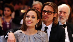 "Angelina Jolie and Brad Pitt attend the ""Cinema for Peace 2012"" charity gala during the 62nd Berlinale film festival in Berlin February 13, 2012. REUTERS/Andreas Rentz/Pool/Files"