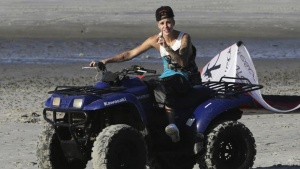Canadian pop singer Justin Bieber performs on a quad bike at the beach as he takes a break in a resort in Punta Chame on the outskirts of Panama City January 27, 2014. REUTERS/Carlos Jasso/Files