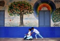 Children play in the corridor of a government-run school in Bangalore September 8, 2014. REUTERS/Abhishek N. Chinnappa