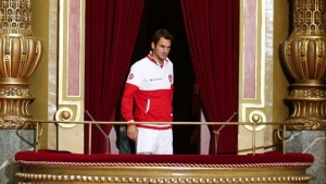 Switzerland's Davis Cup team player Roger Federer arrives on a balcony for a team picture after the draw ceremony at the Victoria Hall in Geneva September 11, 2014. REUTERS/Denis Balibouse