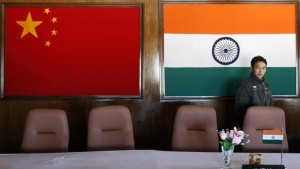 A man walks inside a conference room used for meetings between military commanders of China and India, at the Indian side of the Indo-China border at Bumla, in Arunachal Pradesh, November 11, 2009. REUTERS/Adnan Abidi