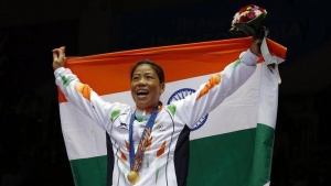 India's gold medallist Chungneijang Mary Kom Hmangte reacts during the medal ceremony for the women's fly (48-51kg) boxing competition at the Seonhak Gymnasium during the 17th Asian Games in Incheon October 1, 2014. REUTERS/Kim Kyung-Hoon