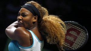 Serena Williams of the U.S. plays a shot against Ana Ivanovic of Serbia during their WTA Finals singles tennis match in Singapore October 20, 2014. REUTERS/Edgar Su