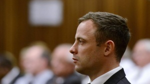 South African Olympic and Paralympic track star Oscar Pistorius attends his sentencing at the North Gauteng High Court in Pretoria October 21, 2014. REUTERS/Herman Verwey/Pool