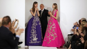 File photo of designer Oscar De La Renta (C) with models after presenting his Autumn/Winter 2013 collection during New York Fashion Week, February 12, 2013. REUTERS/Lucas Jackson/Files