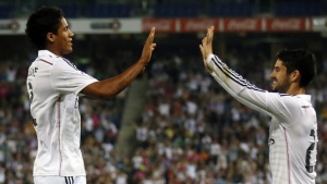Real Madrid's Raphael Varane (L) and Isco celebrate a goal against Cornella during their Spanish King's Cup soccer match at the Cornella-El Prat Stadium near Barcelona, October 29, 2014. REUTERS/Albert Gea
