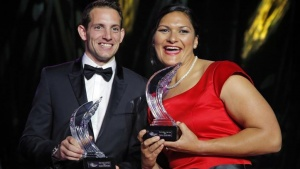Shot putter Valerie Adams of New Zealand (R)  poses with World-record pole vaulter Renaud Lavillenie of France (L) after receiving their 2014 IAAF Athletes of the Year trophies during the IAAF Gala in Monte Carlo November 21, 2014. REUTERS/Eric Gaillard