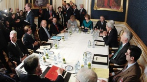 French Foreign Minister Laurent Fabius (3rd L), EU envoy Catherine Ashton (6th L), U.S. Secretary of State John Kerry (3rd R) and Britain's Foreign Secretary Philip Hammond (front L) sit a a table during talks in Vienna November 21, 2014.REUTERS/Heinz-Peter Bader