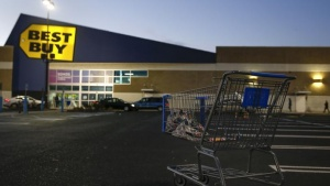 An empty shopping cart is seen outside a Best Buy store in Westbury, New York November 28, 2014. REUTERS/Shannon Stapleton