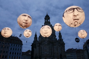 Balloons made by the 'ONE' campaigning organization depicting leaders of the countries in the G7 are seen in front of the Frauenkirche cathedral in Dresden, Germany May 27, 2015. Dresden hosts the G7 finance ministers and central bankers meeting. The balloons show Japanese Prime Minister Shinzo Abe (R), British Prime Minister David Cameron (5th L), French President Francois Hollande (2nd R), German Chancellor Angela Merkel (4th L), U.S. President Barack Obama (2nd L), Italian Prime Minister Matteo Renzi (3rd L) and Canadian Prime Minister Stephen Harper (L). REUTERS/Fabrizio Bensch