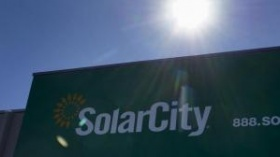 The company's logo is seen on the SolarCity building in Denver in this February 17, 2015 file photo. REUTERS/Rick Wilking/Files
