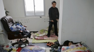 Migrant workers wake up at the offices of a subcontractor company at the construction site of Zixia Garden development complex in Qianan, Tangshan City, Hebei province, China January 28, 2016. REUTERS/Damir Sagolj