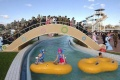 Spectators watch people use The Munsu Water Park in Pyongyang in this undated photo released by North Korea's Korean Central News Agency (KCNA) October 16, 2013. REUTERS/KCNA/Files