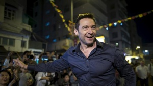 Australian actor Hugh Jackman waves to fans at the 'Tai Hang Fire Dragon Dance' event to celebrate the Mid-Autumn Festival during a trip to promote his film in Hong Kong, September 28, 2015.REUTERS/Tyrone Siu/Files