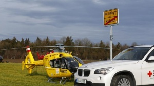 Helicopters of rescue services and an ambulance are seen at a field near Bad Aibling in southwestern Germany, February 9, 2016. REUTERS/Michael Dalder