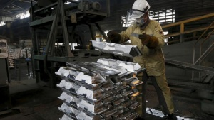A worker stacks aluminium ingots at the foundry shop of the Rusal Sayanogorsk aluminium smelter outside the town of Sayanogorsk, Russia, September 3, 2015. REUTERS/Ilya Naymushin/Files