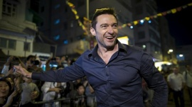 Australian actor Hugh Jackman waves to fans at the 'Tai Hang Fire Dragon Dance' event to celebrate the Mid-Autumn Festival during a trip to promote his film in Hong Kong, September 28, 2015. REUTERS/Tyrone Siu/Files