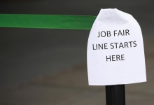 A sign marks the entrance to a job fair in New York in this October 24, 2011 file photo. REUTERS/Shannon Stapleton