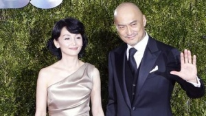 Ken Watanabe  arrives with his wife Kaho Minami for the American Theatre Wing's 69th Annual Tony Awards at the Radio City Music Hall in Manhattan, New York June 7, 2015.  REUTERS/Eduardo Munoz/Files