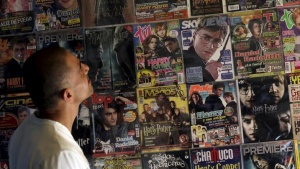 "A man looks on at magazines featuring Harry Potter related on display at the museum called: ""The House of Asher Potter"" in Mexico City, Mexico October 11, 2015. REUTERS/Henry Romero/Files"