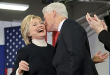 Democratic presidential candidate Hillary Clinton receives a kiss from her husband, former U.S. President Bill Clinton, as she speaks to supporters at her final 2016 New Hampshire presidential primary night rally in Hooksett, New Hampshire February 9, 2016.   REUTERS/Brian Snyder