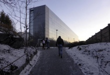 People walk past a building that opened as an asylum centre in February in Lysaker, south of Oslo, Norway, February 3, 2016. TREUTERS/Alister Doyle
