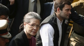 Congress party president Sonia Gandhi (L) and her son Rahul Gandhi, arrive at a court in New Delhi, December 19, 2015. REUTERS/Adnan Abidi/Files