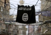 An Islamic State flag hangs amid electric wires over a street in Ain al-Hilweh Palestinian refugee camp, near the port-city of Sidon, southern Lebanon January 19, 2016. Reuters/Ali Hashisho/Files