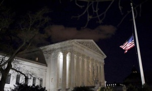 The U.S. flag is seen at half mast at the Supreme Court building in Washington D.C. after the death of U.S. Supreme Court Justice Antonin Scalia, February 13, 2016. REUTERS/Carlos Barria