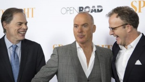 "Executive producer Tim Ortenberg (L), cast member Michael Keaton (C) and director/co-writer Tom McCarthy attend the special screening of ""Spotlight"" at the DGA Theater in Los Angeles, California November 3, 2015. REUTERS/David McNew/Files"