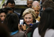 Democratic U.S. presidential candidate Hillary Clinton poses for a selfie after attending a campaign event at the Queens borough of New York April 10, 2016.   REUTERS/Eduardo Munoz