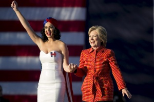 Hillary Clinton arrives with singer Katy Perry during a campaign rally in Des Moines, Iowa, October 24, 2015. REUTERS/Scott Morgan