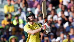 Australia's Steve Smith watches the ball after he hit it for a six during their One Day International cricket match against India in Perth January 12, 2016.     REUTERS/Bill Hatto/Files