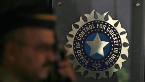A policeman walks past a logo of the Board of Control for Cricket in India (BCCI) at BCCI headquarters in Mumbai April 26, 2010. REUTERS/Arko Datta/Files