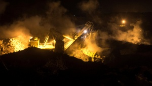 A truck is loaded with top soil at the Jharia burning coal field at Dhanbad district in the eastern state of Jharkhand, India, September 17, 2012. REUTERS/Ahmad Masood/File Photo