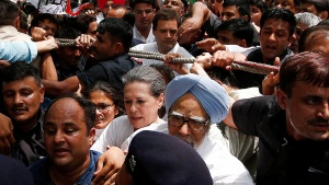 "Congress party president Sonia Gandhi (C), former Prime Minister Manmohan Singh (blue turban) and Congress party vice president Rahul Gandhi (top-C) take part in what the party calls as a ""Save Democracy"" march to parliament in New Delhi, May 6, 2016. REUTERS/Adnan Abidi"