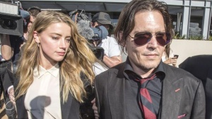 Actor Johnny Depp (R) and wife Amber Heard arrive at the Southport Magistrates Court on Australia's Gold Coast, April 18, 2016. REUTERS/Dave Hunt/AAP/Files