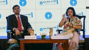 State Bank of India (SBI) chairwoman Arundhati Bhattacharya speaks as Reserve Bank of India (RBI) Governor Raghuram Rajan looks on during an industry event in Mumbai, India, August 20, 2015. REUTERS/Danish Siddiqui/Files