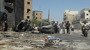 Civilians inspect a site hit by an airstrike in the rebel-controlled city of Idlib, Syria June 29, 2016. REUTERS/Ammar Abdullah