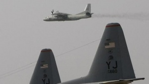 An Indian Air Force (IAF) AN-32 aircraft flies over the C-130H aircrafts of the U.S. Air Force during 'Cope-India-09', a joint exercise between the IAF and the U.S. Air Force in Agra, October 19, 2009. A six-day joint exercise begins here on Monday. REUTERS/Adnan Abidi/files
