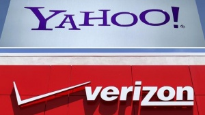 A combination photo shows Yahoo logo in Rolle, Switzerland (top) in 2012 and a Verizon sign at a retail store in San Diego, California, U.S. In 2016. REUTERS/Files