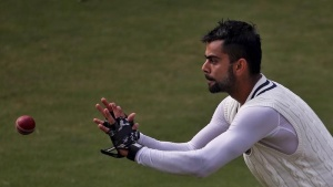 Virat Kohli prepares to catch the ball during a practice session ahead of their fourth and final test cricket match against South Africa, in New Delhi, December 2, 2015. REUTERS/Anindito Mukherjee/Files